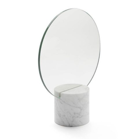 Round mirror and white marble support