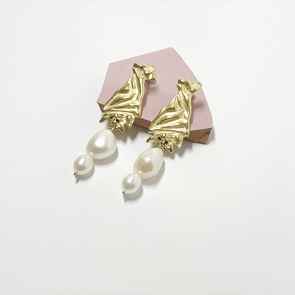 Gold bat earrings with double pearl